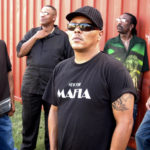 """Ivan Neville (at center) and """"Dumpstaphunk."""""""
