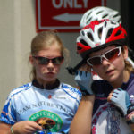 Junior girl riders Mallory McNelis (Left) and Kristin Schaefer check their times after impressive performances.