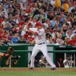 Nationals third baseman (and former UVa standout) Ryan Zimmerman bats as Red Sox catcher Jason Varitek gives the target.