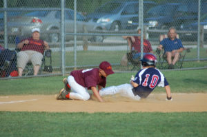 Nationals baserunner #10 Holden Hurt tries to beat the throw to third.