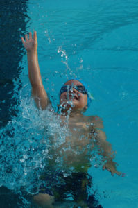 Ashley Plantation's Jackson Wolfe has the water flying during his backstroke event.
