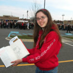 """Tess Lynch, 13, shows off her signed copy of """"Going Rogue."""""""