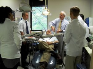 """Dr. Charles """"Bud"""" Conklin teaches Virginia Tech Carilion School of Medicine students how to perform an oral exam."""