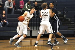 Hidden Valley's Dylan Hodson drives around the pick of teammate #22 Ben Munsey as the Titans overcame an early 17-point deficit to defeat Christiansburg. Hodson led all scorers with 23 points.