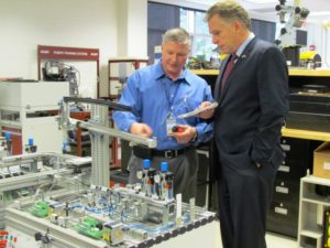 Dan Horine demonstrates part of the VWCC robotic lab to Terry McAuliffe.