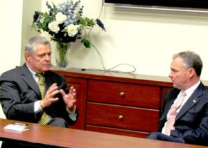 Mayor David Bowers (L) discusses the issues with Senator Time Kaine.