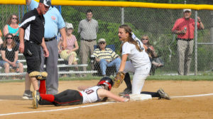 Cave Spring baserunner Kylie Kent dives to the bag at third, just beating the tag of Hidden Valley third baseman Savannah Kramer.