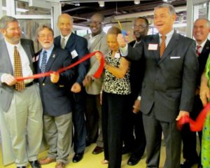 """""""Mayor Bowers cuts the ribbon to the entrance of the Harrison Museum."""""""