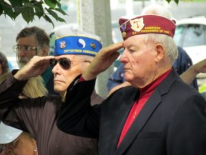 Alvin Hudson and Robert Gray salute the flag under which they fought to defend the freedom we all enjoy.