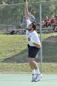Hidden Valley's Tim Roehr serves Tuesday afternoon as the Titans remained undefeated on the season.