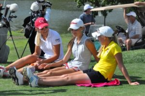 (L-R) Meagan Board, Lyndsey Hunnell and Kristin Hearp sit on the sixth-hole tee box at Blue Hills on Thursday, waiting for the fairway in front to clear. The three played together in the final marquee group.