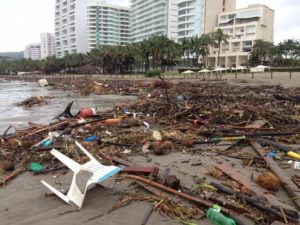 Debris litters the once pristine beaches in Acapulco.