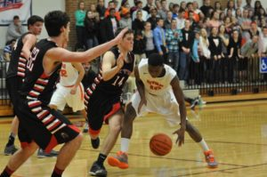 Wm. Byrd's Marvey'o Otey looks to drive past Cave Spring defenders #14 Alex Emery and #52 Noah St. Clair Tuesday night. Otey had a game-high 30 points for the Terriers.