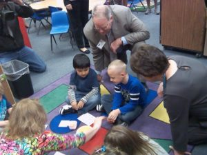"""""""Children's Cabinet"""" members Bill Hazel (center) and Ann Holton meet with Fallon Park students."""