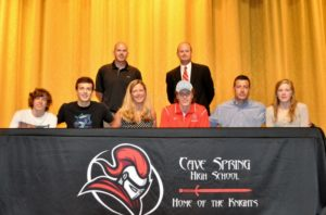 {L-R seated) Brothers Dawson and Brody, mom Cherie Hicks, Cager, dad Billy Hicks and sister Ainslee. Standing- Cave Spring assistant coach Derrick Roth (L) and Cave Spring head basketball coach Jacob Gruse.