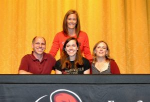 Sydney McTigue flanked by parents Stephen and Prina McTigue, along with Cave Spring head volleyball coach Tamalyn Tanis.