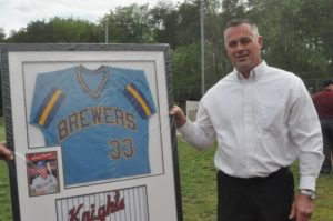 Former Cave Spring, Va. Tech and Milwaukee Brewer baseball star George Canale poses with his framed jersey that will be permanently displayed in the lobby of Cave Spring High School.