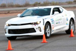 The Virginia Tech Hybrid Electric Vehicle Team's Camaro takes to the track at the Yuma, Arizona, GM Desert Proving Grounds in May as part of the EcoCAR 3 competition. Of 16 collegiate teams, Virginia Tech was the only one to use a V-8 engine in the iconic sports car. The team placed second overall. Photo by Myles Regan