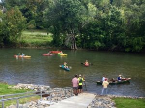 Kayakers take to the water after Tuesday's ribbon cutting.